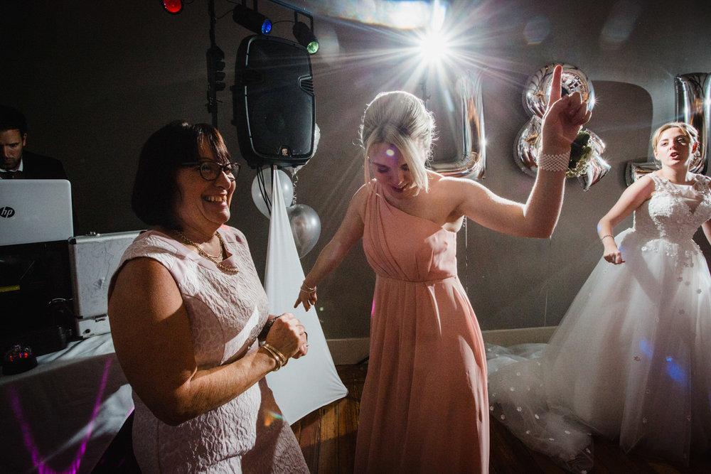 bridesmaid dancing in front of mum on dancefloor