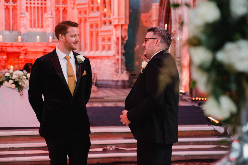 groom and best man waiting at the top of the aisle