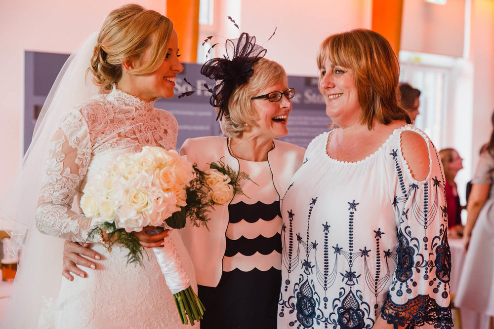 mother of bride laughing and joking with relatives