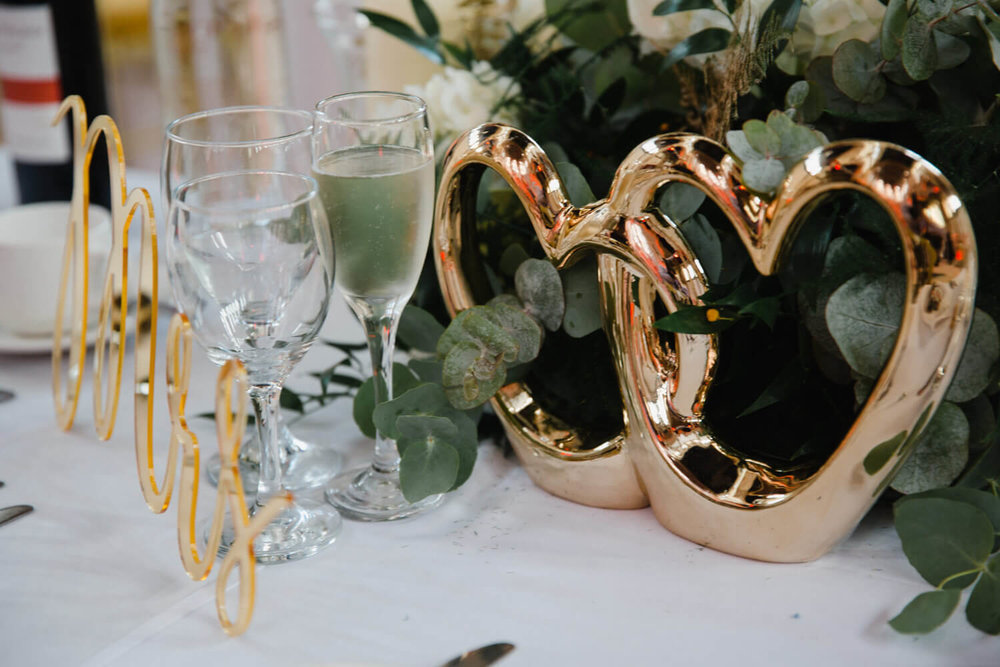 gold heart table decorations on top table