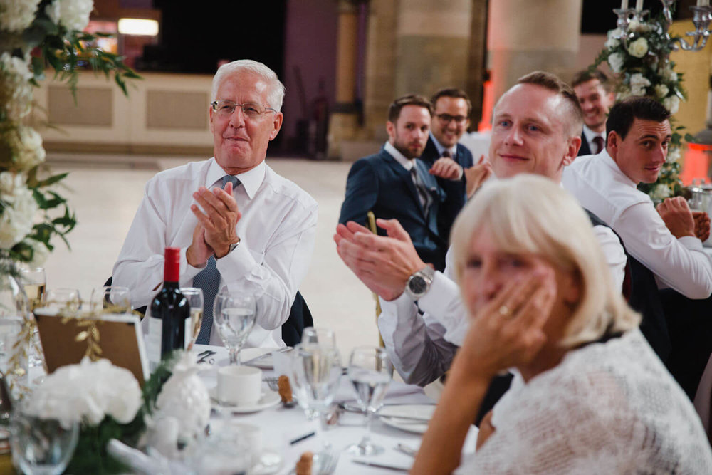wedding guests applauding the grooms speech