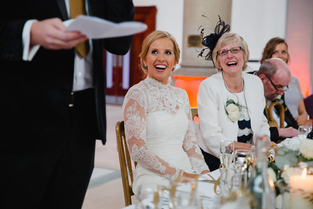 bride with mother laughing at grooms speech