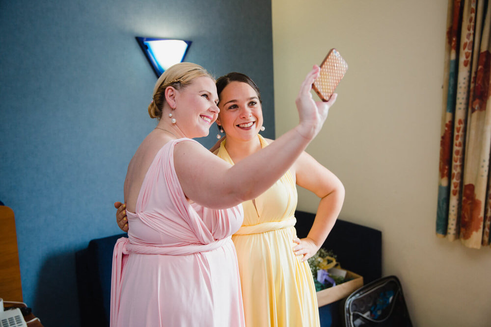 bridesmaids taking a selfie together
