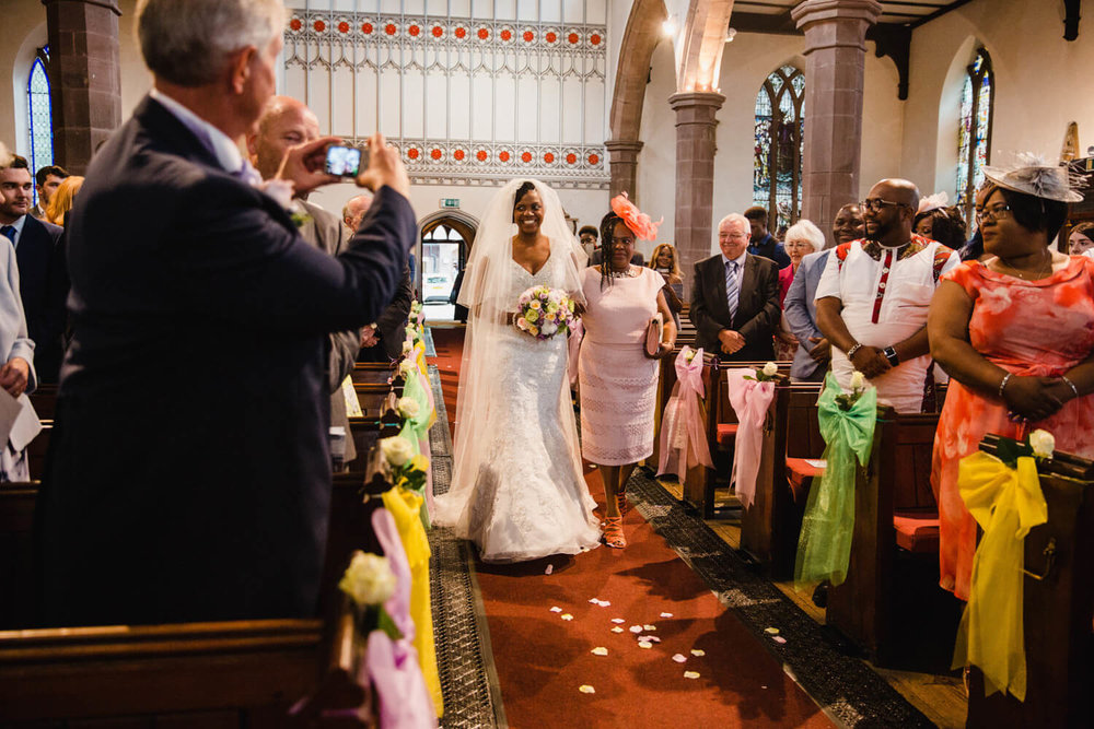 bride walking down aisle at beginning of ceremony