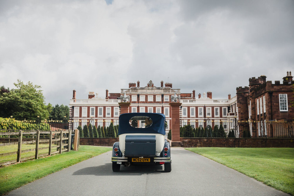 wedding car driving in to knowsley hall