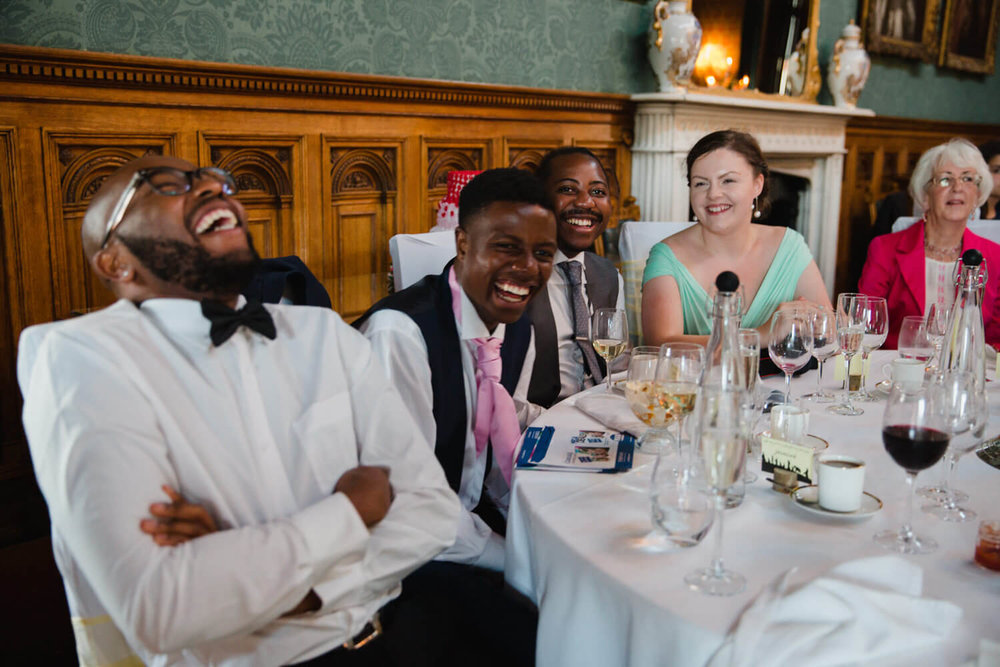 wedding guests laughing out loud at speeches