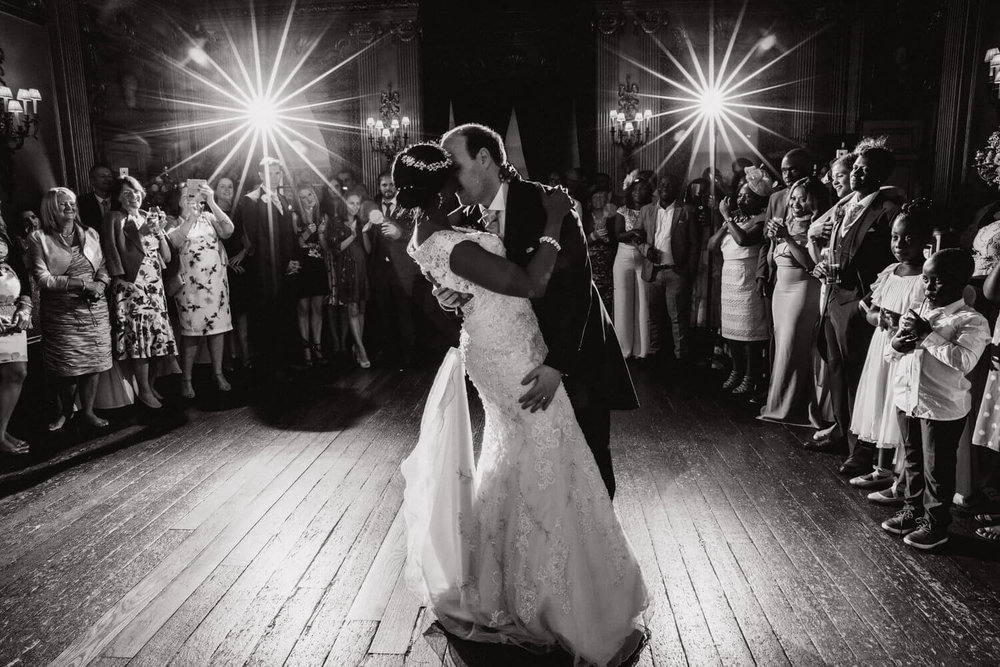 groom holding bride during first dance at knowsley hall