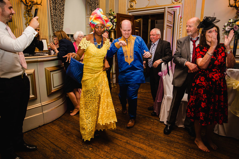 Bride and Groom in traditional african clothing for wedding dance at knowsley hall