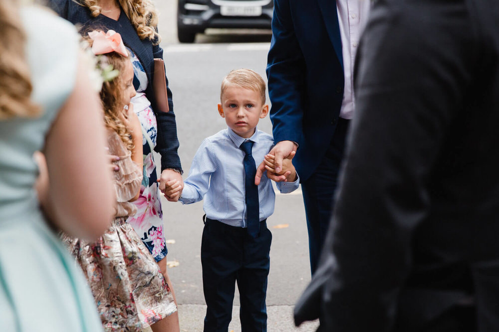 page-bot holding hands with family outside church