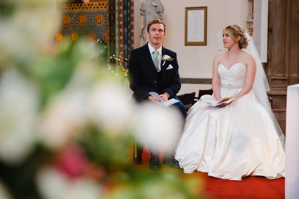 bride glances over to groom with a smile during ceremony