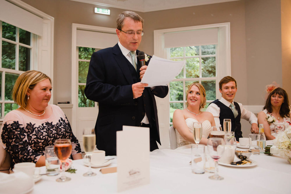 father of groom giving speech to room