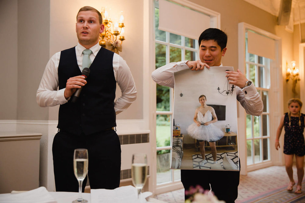 best men speech reveal a picture of groom on stag do