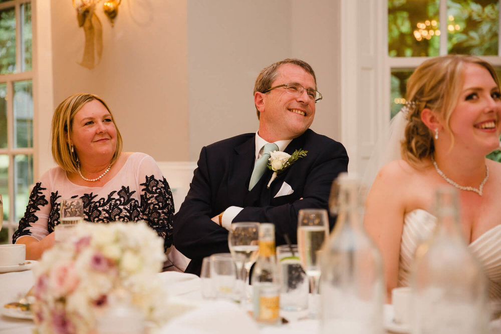 top table family all laughing at best-man speech