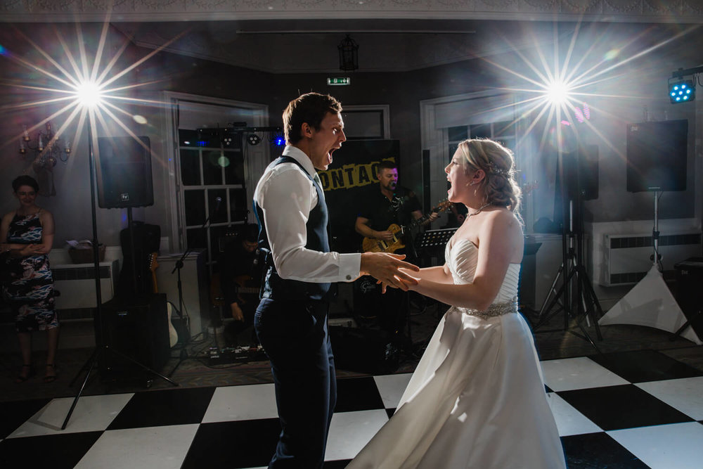 Married Couple dancing at end of wedding day