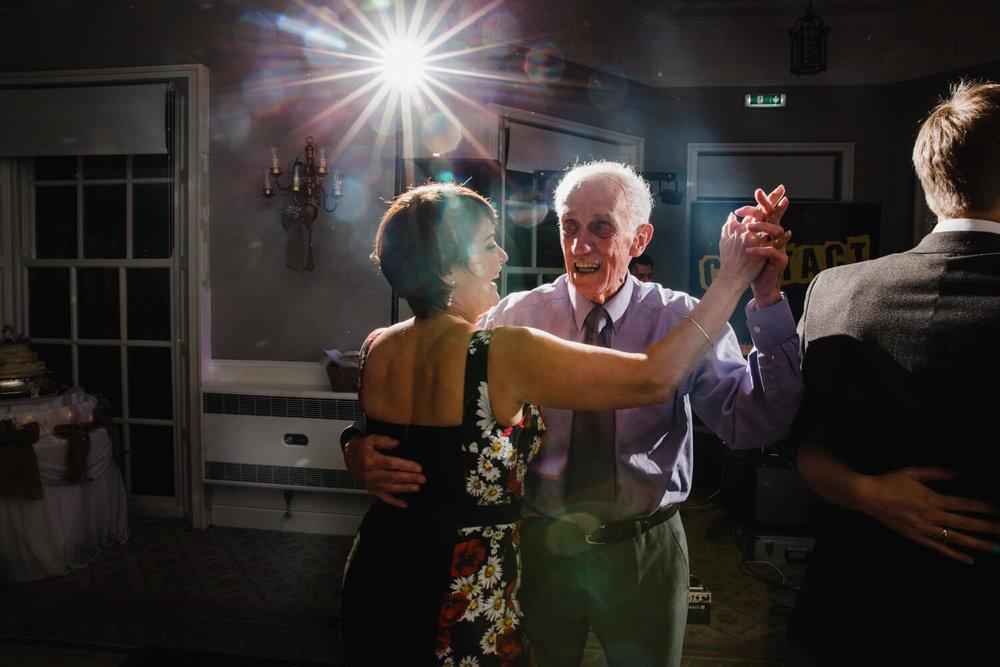 grandparents dance together on floor at Statham Lodge