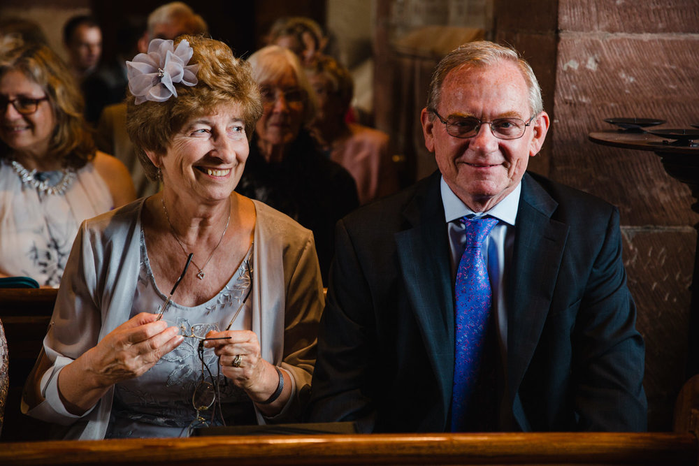 wedding guests sat in church waiting for ceremony to begin