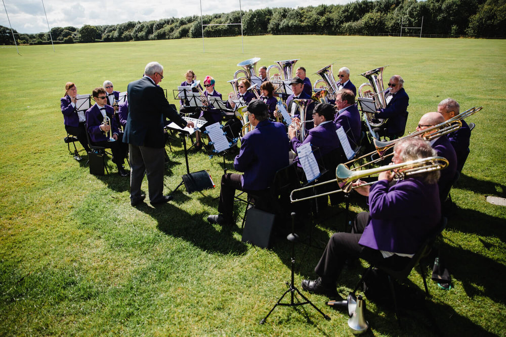 brass band playing music in sports field