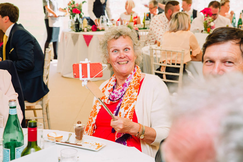 wedding guest grandma with selfie stick