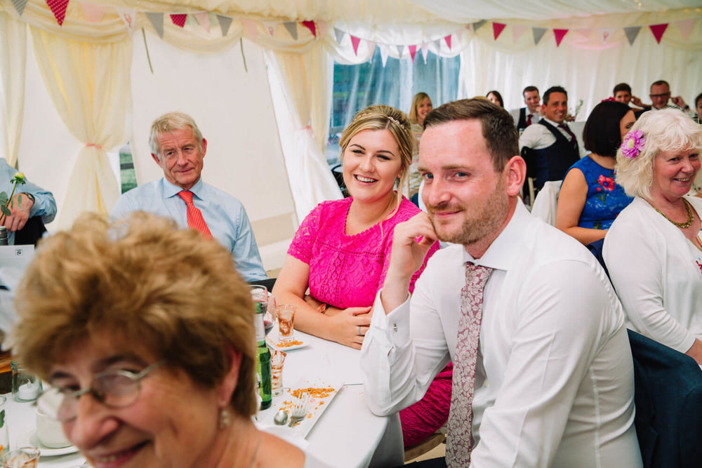wedding guests laughing at speeches