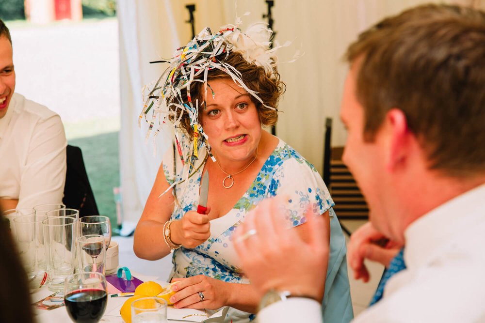 wedding guest with shredded paper on her head