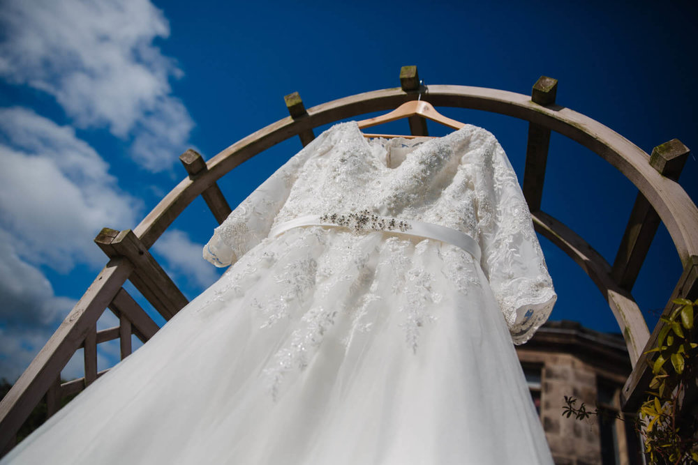 close up of wedding dress on pagoda