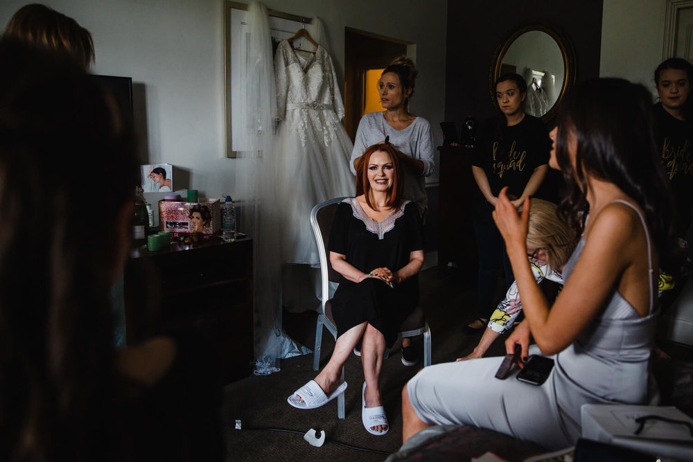 mother of bride having hair prepared