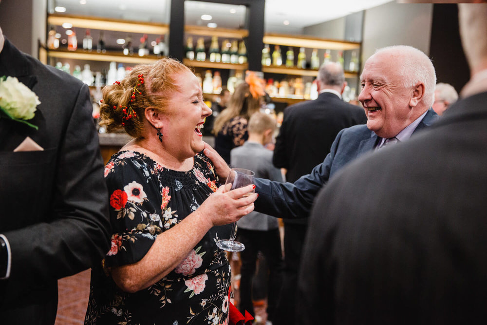 uncle and auntie sharing a joke at the bar