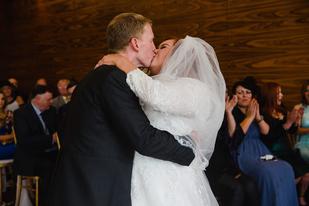 first kiss of bride and groom