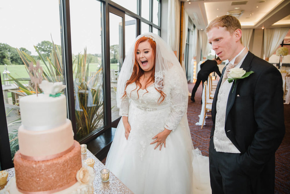 bride first reaction to seeing wedding cake for first time