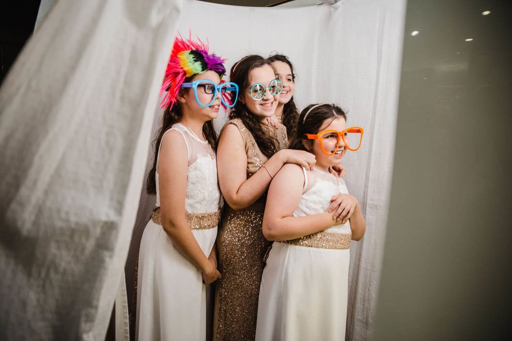 bridesmaids in fancy dress for the photography booth