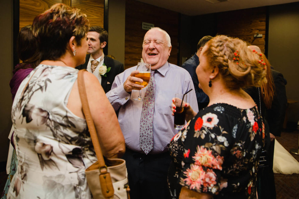 uncle enjoying a laugh with guests