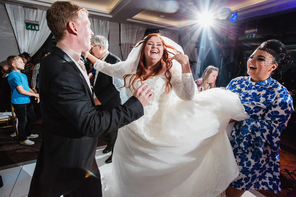 bride dancing to music with newly wedded husband