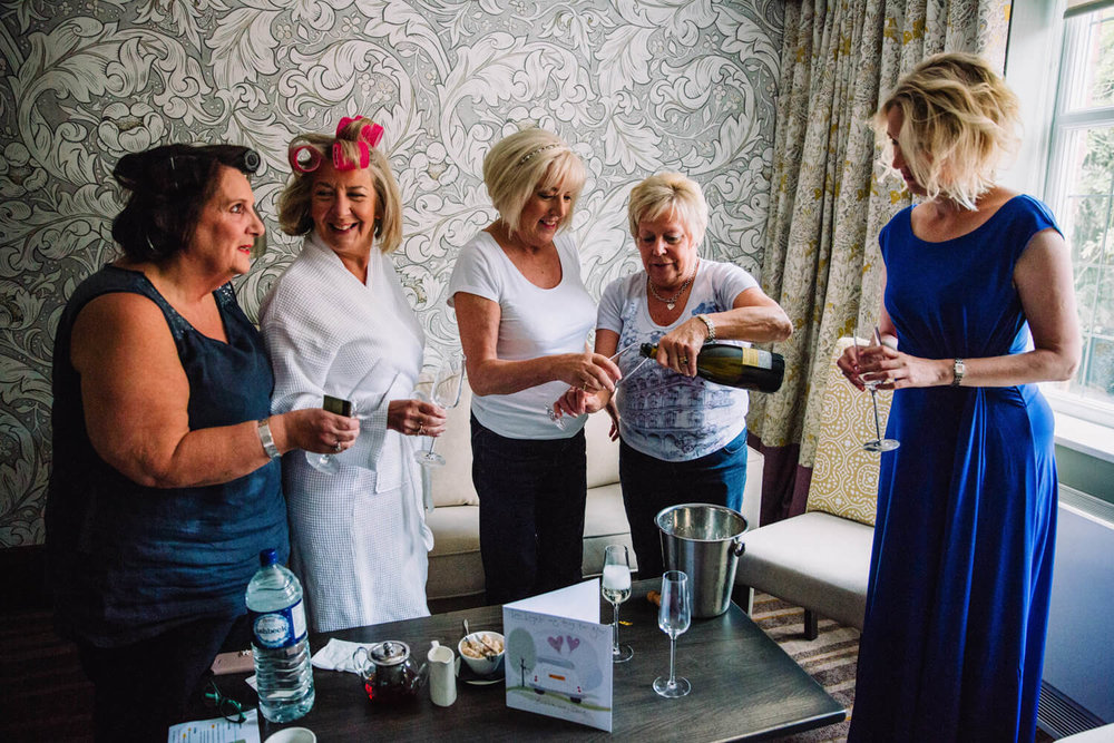 bridal party pouring champagne drinks