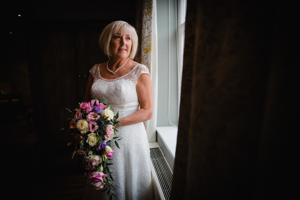 portrait of bride in wedding dress holding bouquet