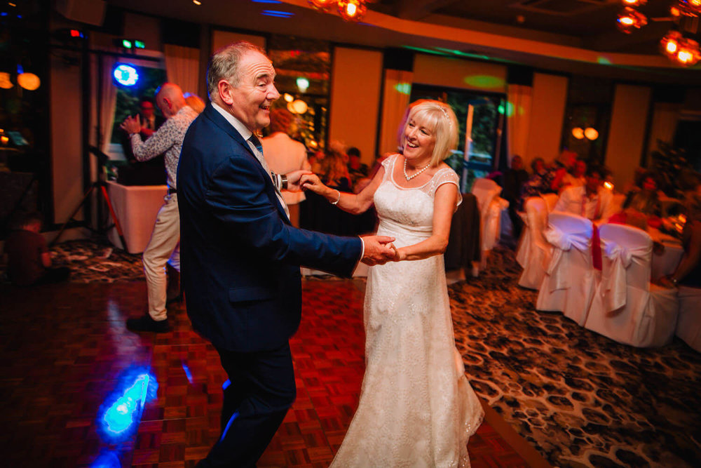 newlyweds celebrating on the dance floor