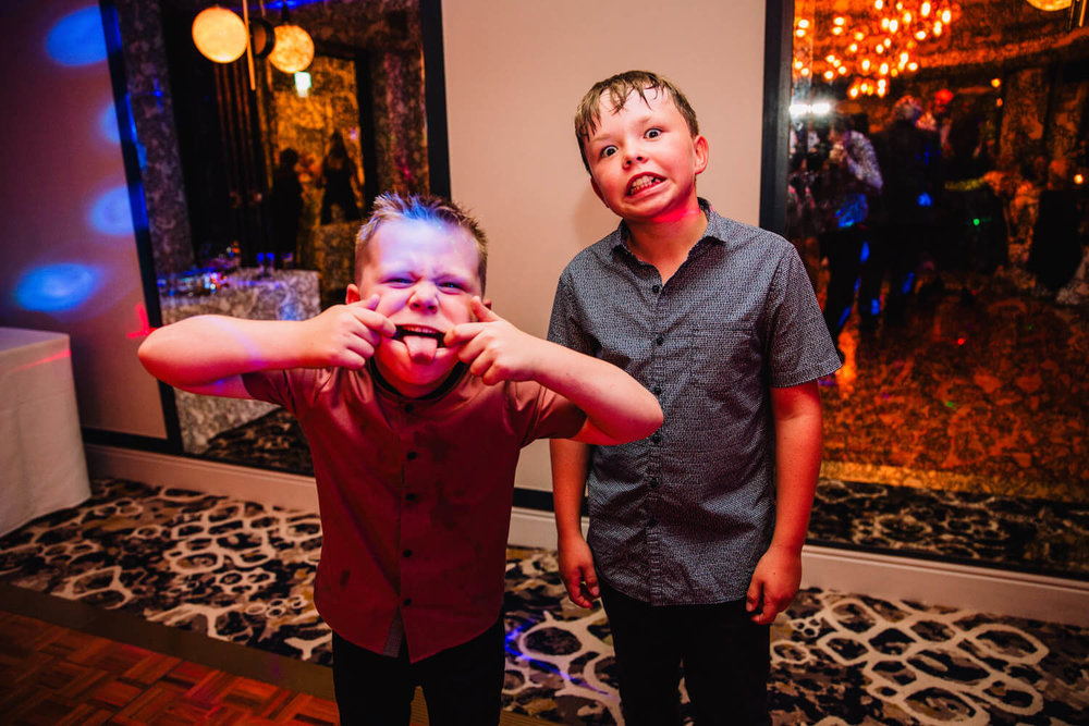 pageboys pulling faces to camera