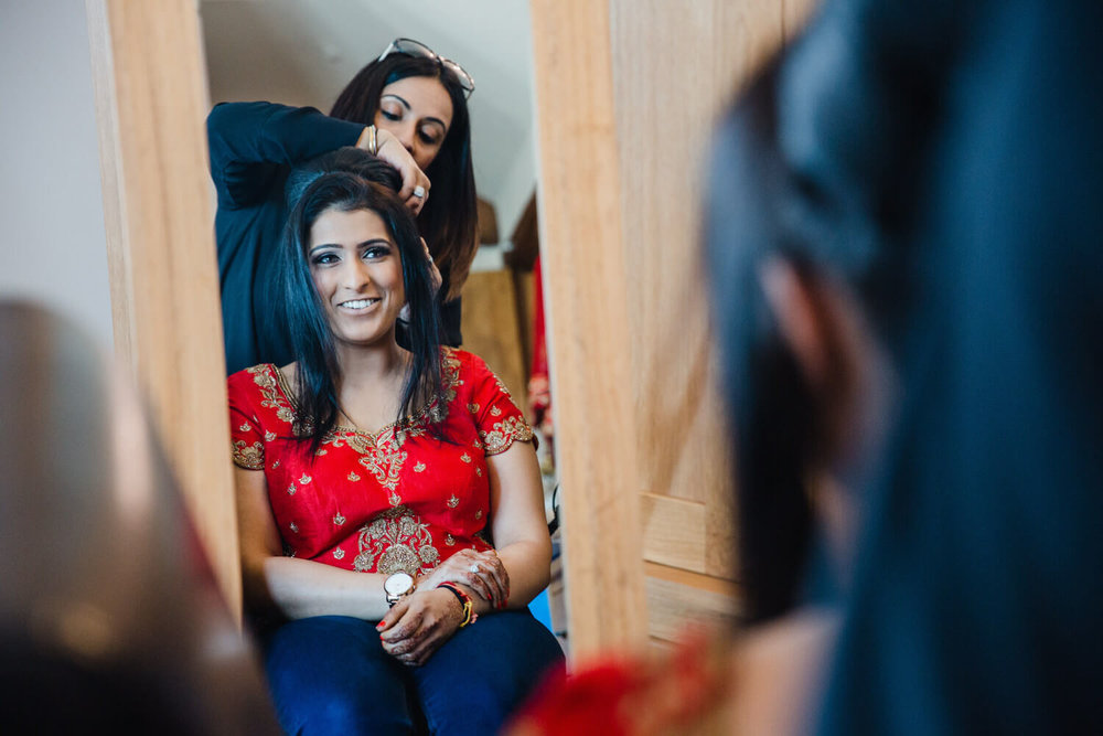 Bridal preparation in mirror before ceremony begins