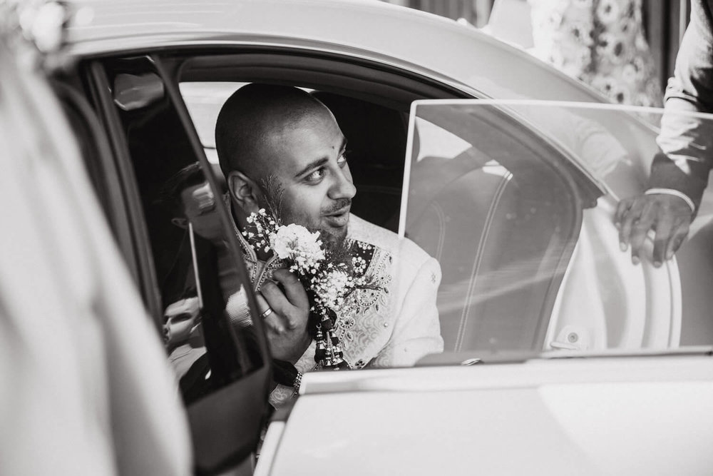 groom looking out at party from car