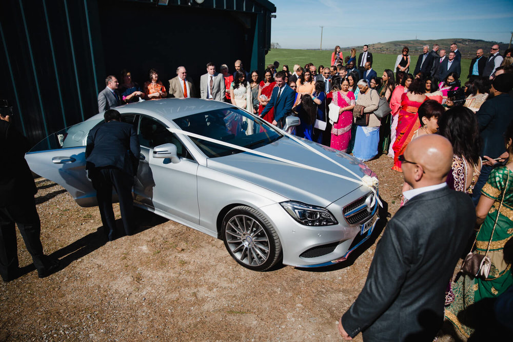 wedding car arriving at heaton house farm
