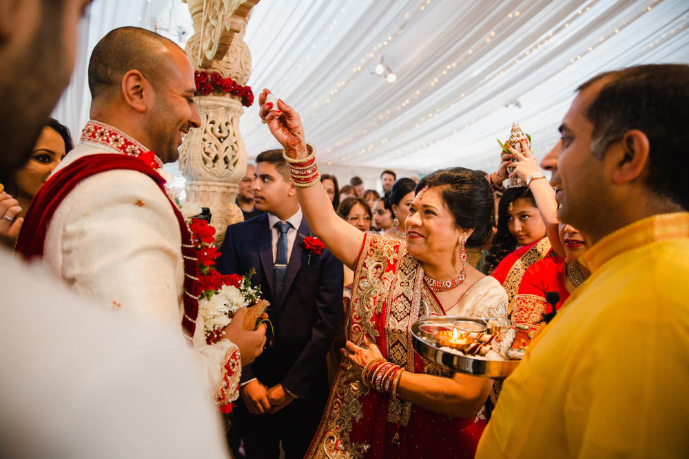 mother of groom blesses son