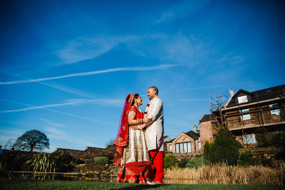bride and groom wide angle lens portrait in gardens at heaton house farm