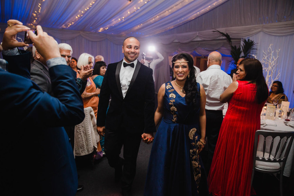 bride and groom entrance into reception room