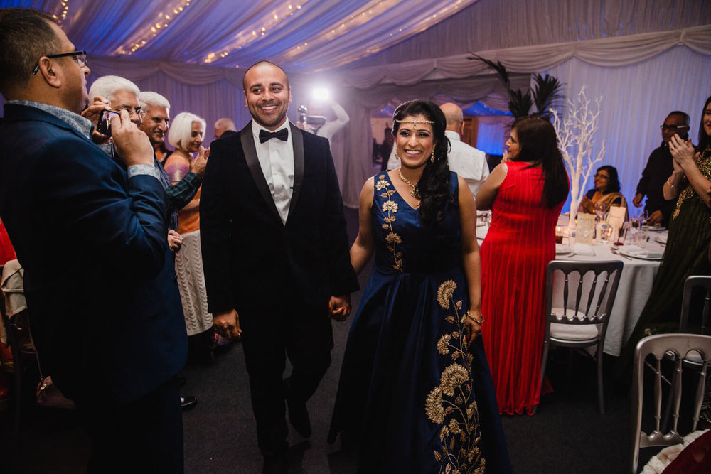 newlyweds cheering entering wedding reception room