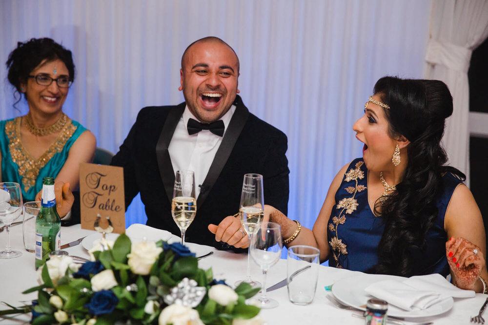 groom laughing at joke on top table