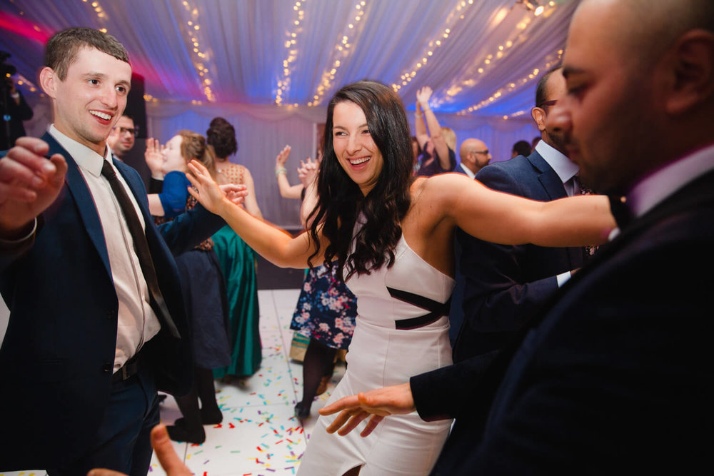 wedding guests partying hard on the dance floor