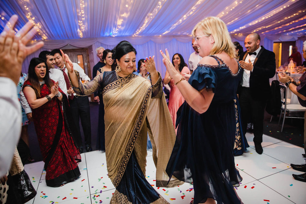 bridesmaids dancing together to music