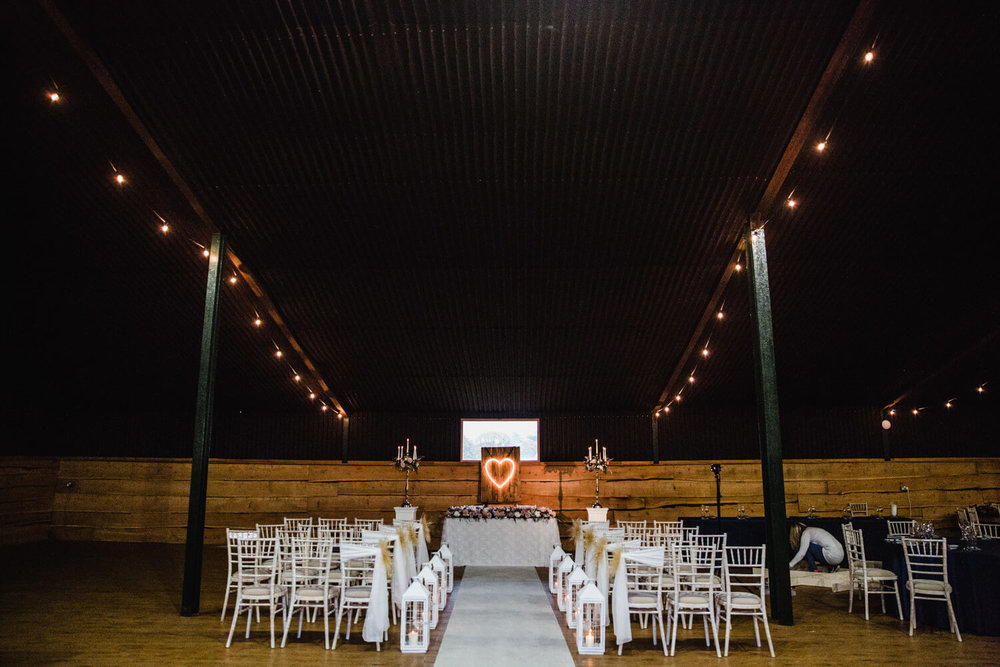 Wedding Ceremony Arrangement with Aisle down the centre