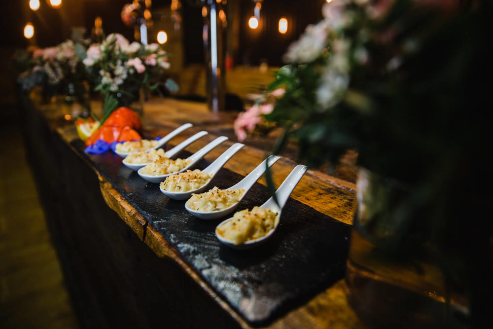 canapé spoons on bar with food