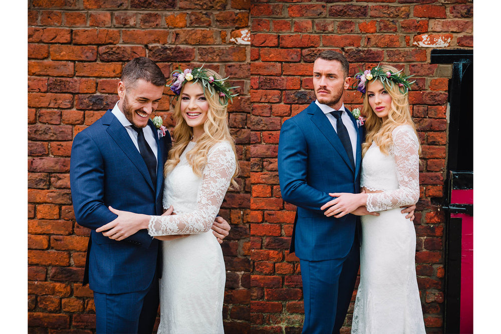 bride and groom holding each other for portraits in front of stables