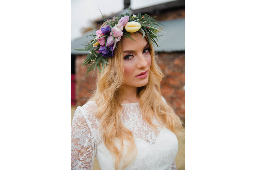 bride looking at camera for floral tiara portrait